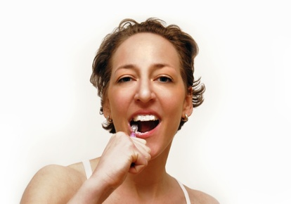 Toothpaste without triclosan and microbeads: Woman brushing teeth